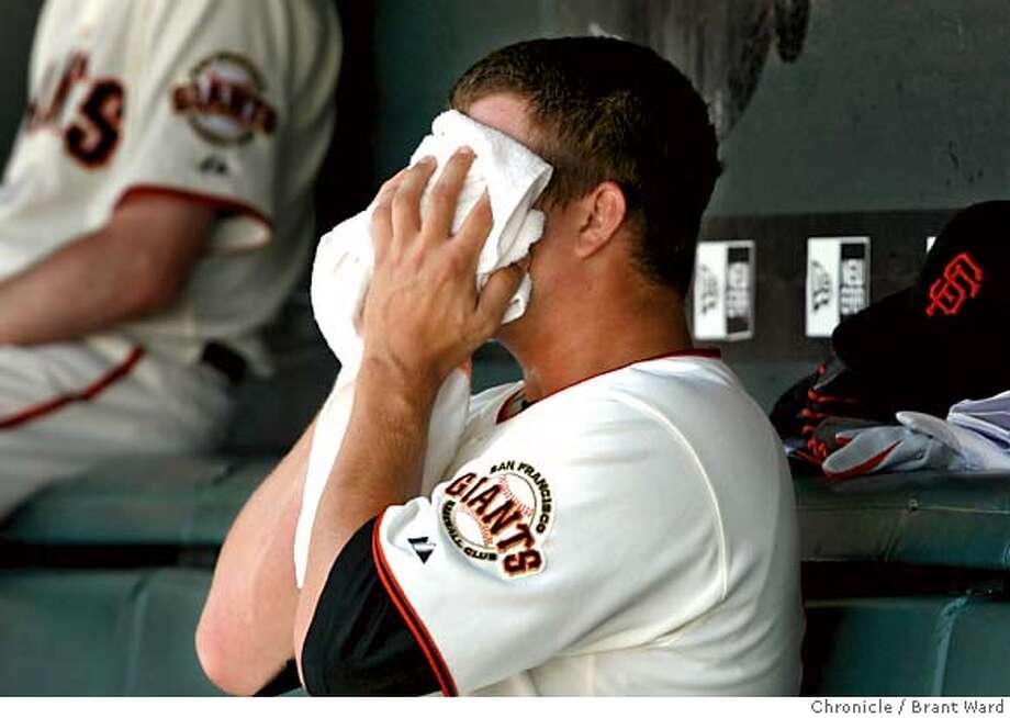 Matt Cain buried his head in a towel after being removed from the game after the Giants fell behind 2-1.  The San Francisco Giants in action against the San Diego Padres at AT&T Park.  {Brant Ward/San Francisco Chronicle}6/27/07 Photo: Brant Ward