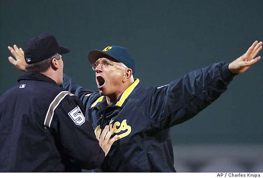 Oakland Athletics manager Ken Macha, right, argues a call in the sixth inning with third base umpire Bill Welke, left, about stopping play during action in game 3 of the American League Divisional Series playoff Saturday, Oct. 4, 2003 at Fenway Park in Boston. (AP Photo/Charles Krupa ) Photo: CHARLES KRUPA
