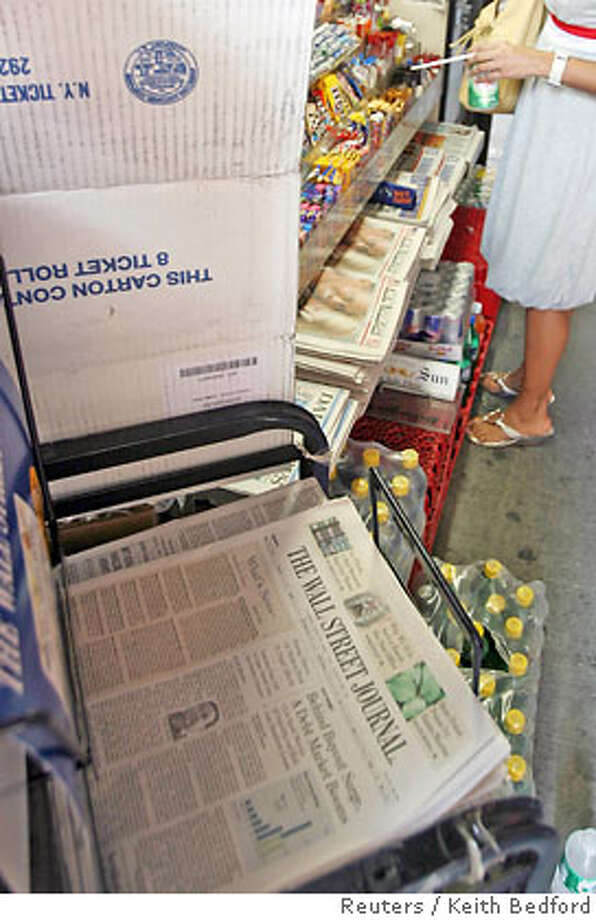"""A copy of the Wall Street Journal is pictured in a newsstand in New York, June 26, 2007. Rupert Murdoch's News Corp. and Dow Jones & Co. Inc. have """"basically agreed"""" on a structure to protect the editorial independence of Dow Jones' news operations, a source familiar with the matter said on Tuesday. News Corp. is offering $5 billion to buy Dow Jones. REUTERS/Keith Bedford (UNITED STATES) Photo: KEITH BEDFORD"""