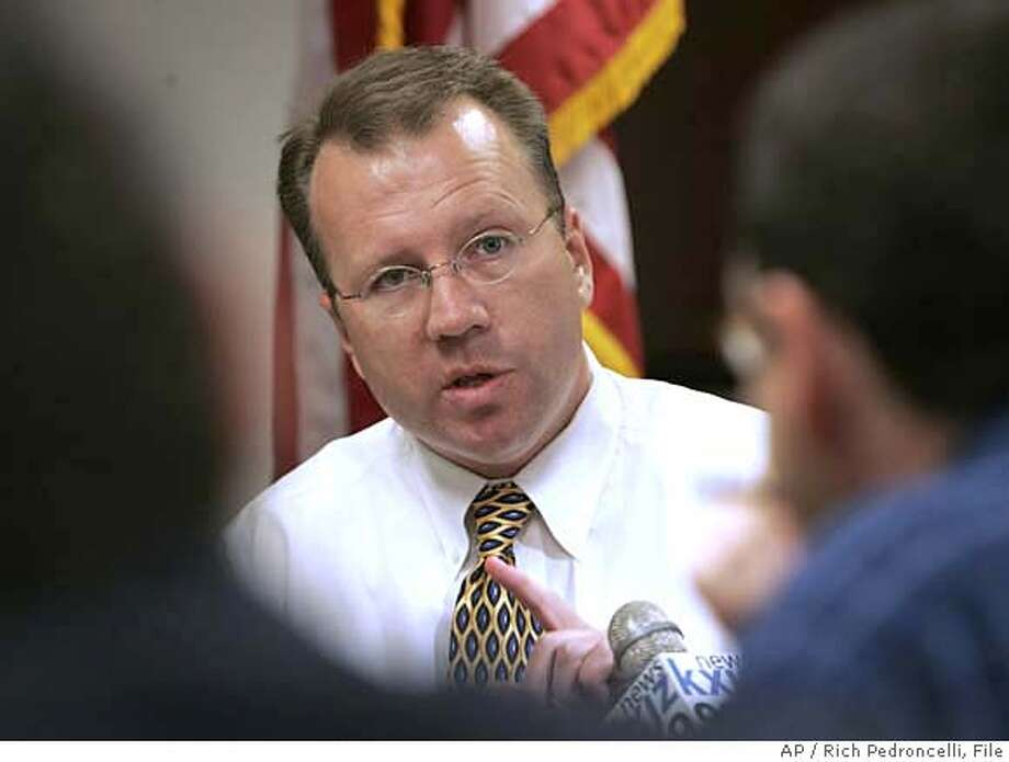 Ron Nehring, center, who was elected as chairman of the California Republican Party in last weekend's state convention, answers reporters question during a news conference, Wednesday, Feb. 14, 2007, held in Sacramento, Calif. (AP Photo/Rich Pedroncelli) STAND ALONE PHOTO Photo: Rich Pedroncelli