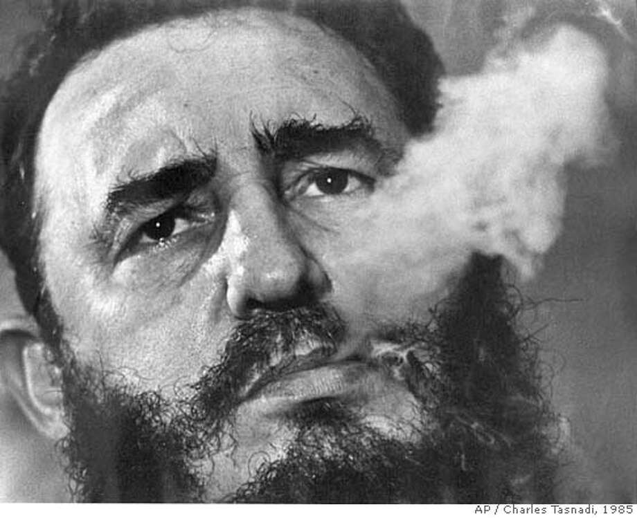 "** FILE ** Fidel Castro exhales cigar smoke in this March 1985 file photo during an interview in Havana. According to newly declassified CIA papers released Tuesday, June 26, 2007, the CIA recruited a former FBI agent to approach two of America's most-wanted mobsters and gave them poison pills meant for Fidel Castro during his first year in power. Contained amid hundreds of pages of CIA internal reports collectively known as ""the family jewels,"" the official confirmation of the 1960 plot against Castro was certain to be welcomed by communist authorities as more proof of their longstanding claims that the United States wants Castro dead. (AP Photo/ Charles Tasnadi) EFE OUT - 1985 FILE PHOTO Photo: Charles Tasnadi"