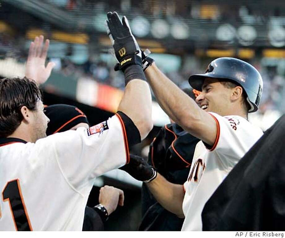 San Francisco Giants' Omar Vizquel is greeted by teammate Ryan Klesko, left, after hitting a solo home run off San Diego Padres starting pitcher Justin Germano during the first inning of their baseball game in San Francisco, Monday, June 25, 2007. (AP Photo/Eric Risberg) Photo: Eric Risberg