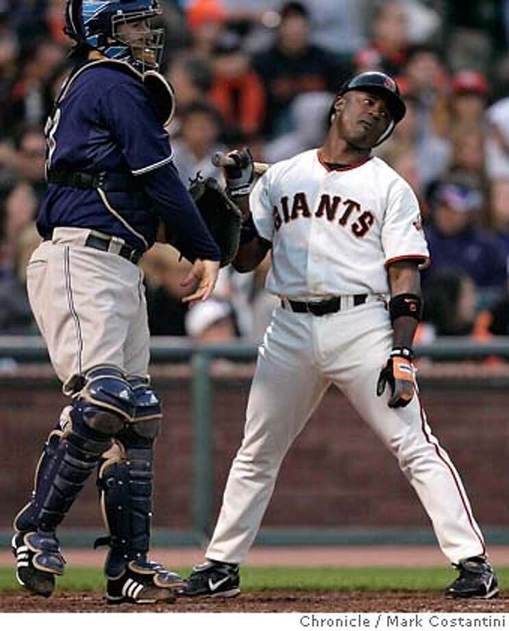 batter Ray Durham looks frustrated after a call strike in the fourth inning as Padres catcher Josh Bard throws ball back to the pitcher. On the next pitch, Durham flied out with the bases loaded to end the inning. v. San Diego Padres at AT&T Park PHOTO: Mark Costantini / The Chronicle Photo: MARK COSTANTINI