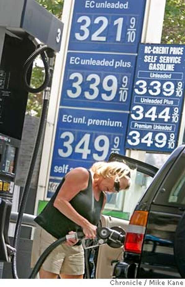 GASPRICE_080_MBK.JPG Terry McLendon of San Francisco fills her tank at an RC gas station in the Castro where gas prices are as low as $ 3.21 for regular in San Francisco, CA, on Tuesday, June, 26, 2007. photo taken: 6/26/07  Mike Kane / The Chronicle *Terry McLendon MANDATORY CREDIT FOR PHOTOG AND SF CHRONICLE/NO SALES-MAGS OUT Photo: MIKE KANE