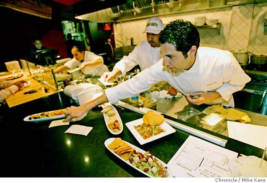 WHATS27_DF_140.JPG  Head Chef David Rosales checks an order at Mexico DF, a new high-profile upscale Mexican restaurant serving large and small plates inspired by the Mexican capital, in San Francisco, CA, on Thursday, June, 21, 2007. photo taken: 6/21/07  Mike Kane / The Chronicle * David Rosales MANDATORY CREDIT FOR PHOTOG AND SF CHRONICLE/NO SALES-MAGS OUT Photo: MIKE KANE