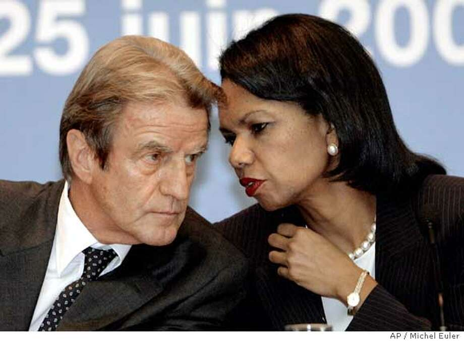 "U.S. Secretary of State Condoleezza Rice, right, talks to French Foreign Minister Bernard Kouchner during their press conference after a one-day conference about Darfur, Monday, June 25, 2007 in Paris. Rice said Monday that Sudan's ""history"" of backsliding on commitments means that sanctions pressure must be maintained, despite its acceptance of a planned larger peacekeeping force for Darfur. (AP Photo/Michel Euler) Photo: MICHEL EULER"