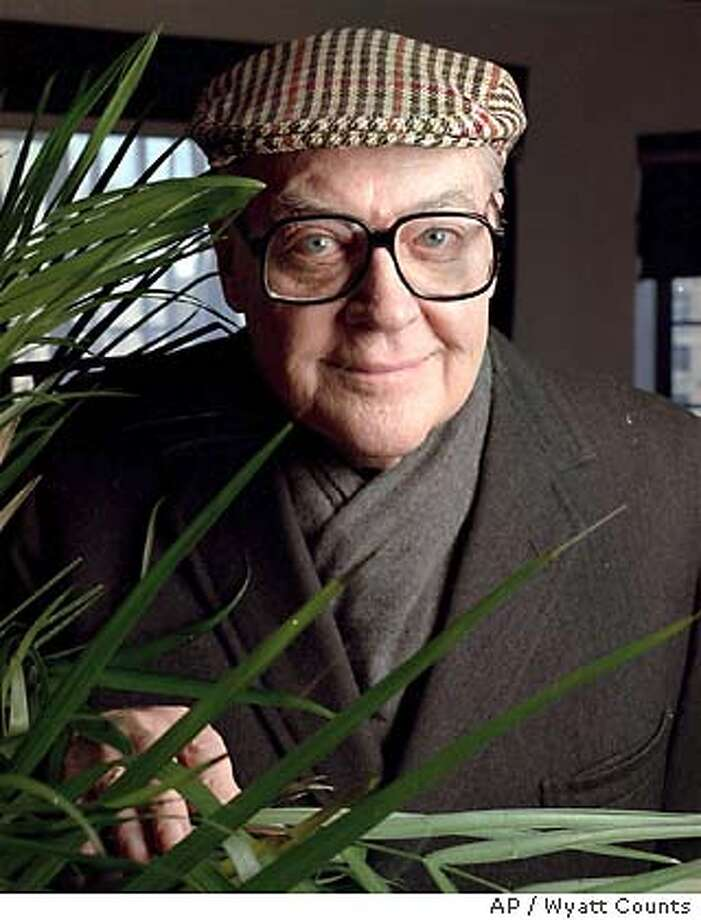 CONDON02.jpg  Storyteller: Author peers from behind a plant during an interview in New York in February. Condon loves telling a good story and has written 22 novels, including The Manchurian Candidate and Prizzi's Honor, both made into popular movies. is new Emperor of America is a wild satire on American politics of the past decade. (AP P{hoto/WYATT COUNTS Photo: WYATT COUNTS
