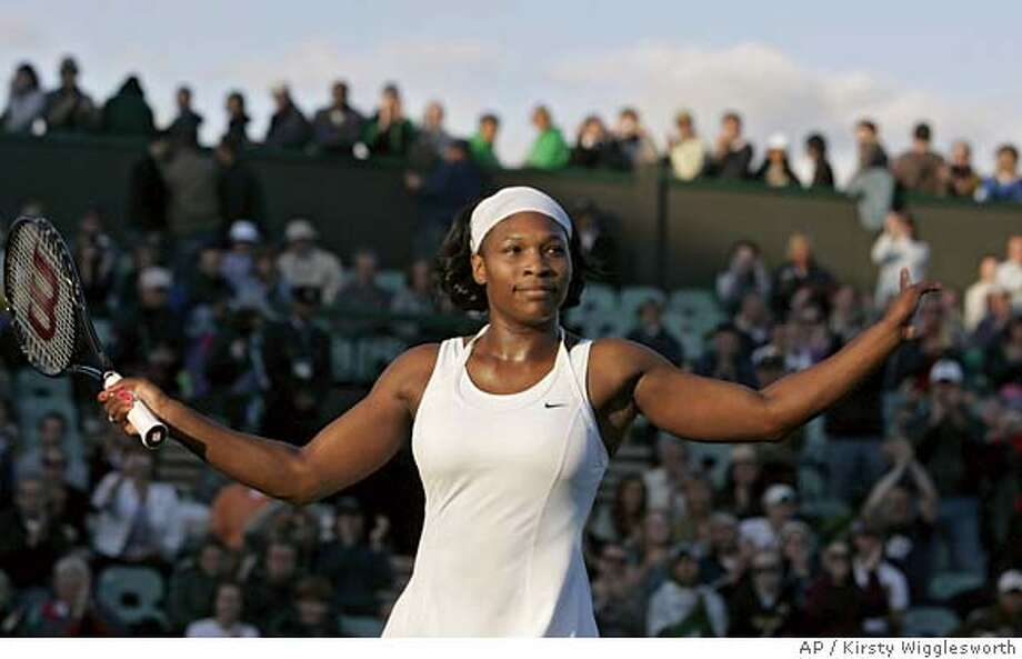 Serena Williams reacts after defeating Spain's Lourdes Dominguez-Lino, during their Women's Singles, first round match at Wimbledon, Monday June 25, 2007. (AP Photo/Kirsty Wigglesworth) ** EDITORIAL USE ONLY ** EDITORIAL USE ONLY Photo: KIRSTY WIGGLESWORTH