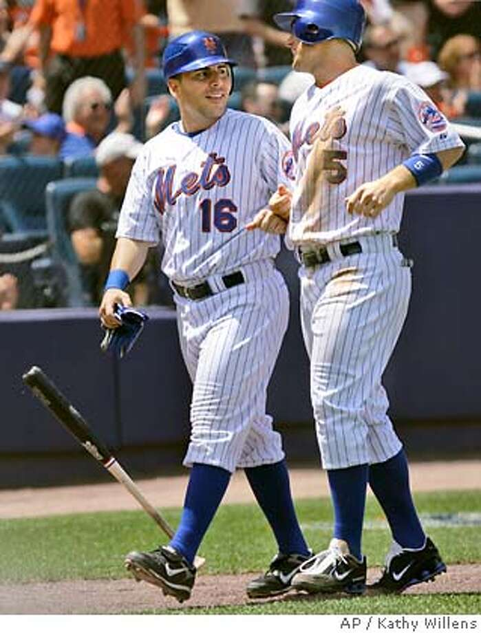 Paul Lo Duca, left, smiles at teammate David Wright after they both scored on Damion Easley's third-inning, two-run double in the Mets' 10-2 win over the Oakland Athletics in their interleague baseball game at Shea Stadium in New York, Sunday, June 24, 2007. (AP Photo/Kathy Willens) Photo: Kathy Willens