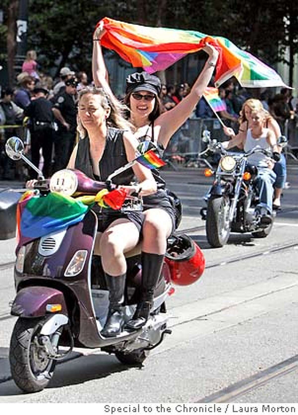 """The group """"Dykes on Bikes"""" started off the LGBT Pride Parade down Market St. Sunday morning in San Francisco, CA. (Laura Morton/Special to the Chronicle)"""