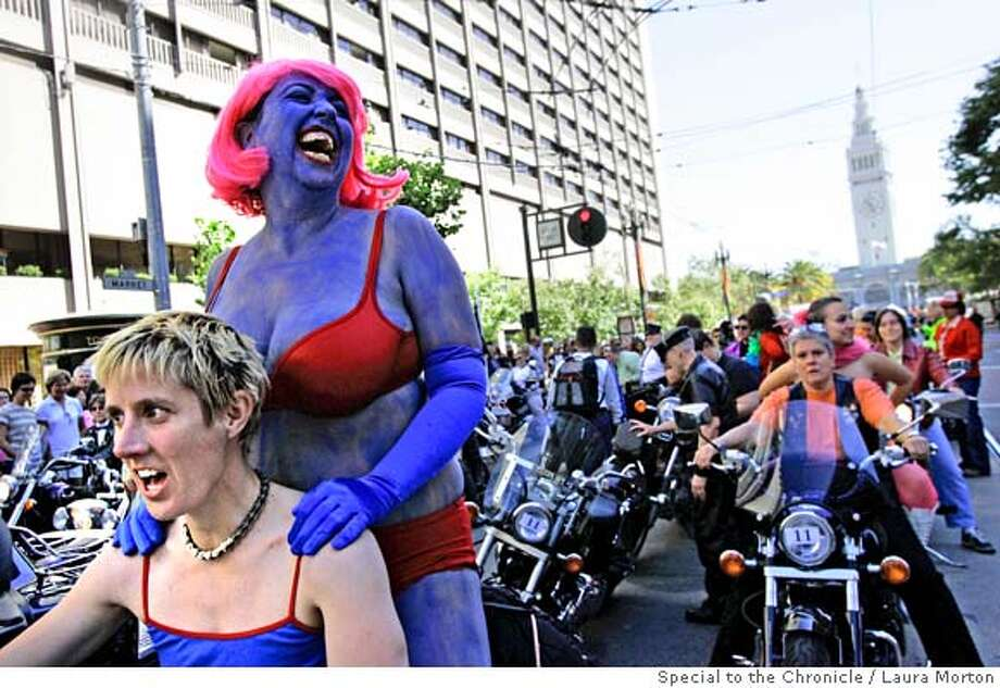 "An Marie Rodgers (left) and Jewlia Eisenberg wait on their motorcycle for the LGBT Pride Parade to start on Market St. in San Francisco, CA. When asked about their costume choice, Rodgers said they thought it would be fun to go as ""Super Gay.""  Photo: Laura Morton"