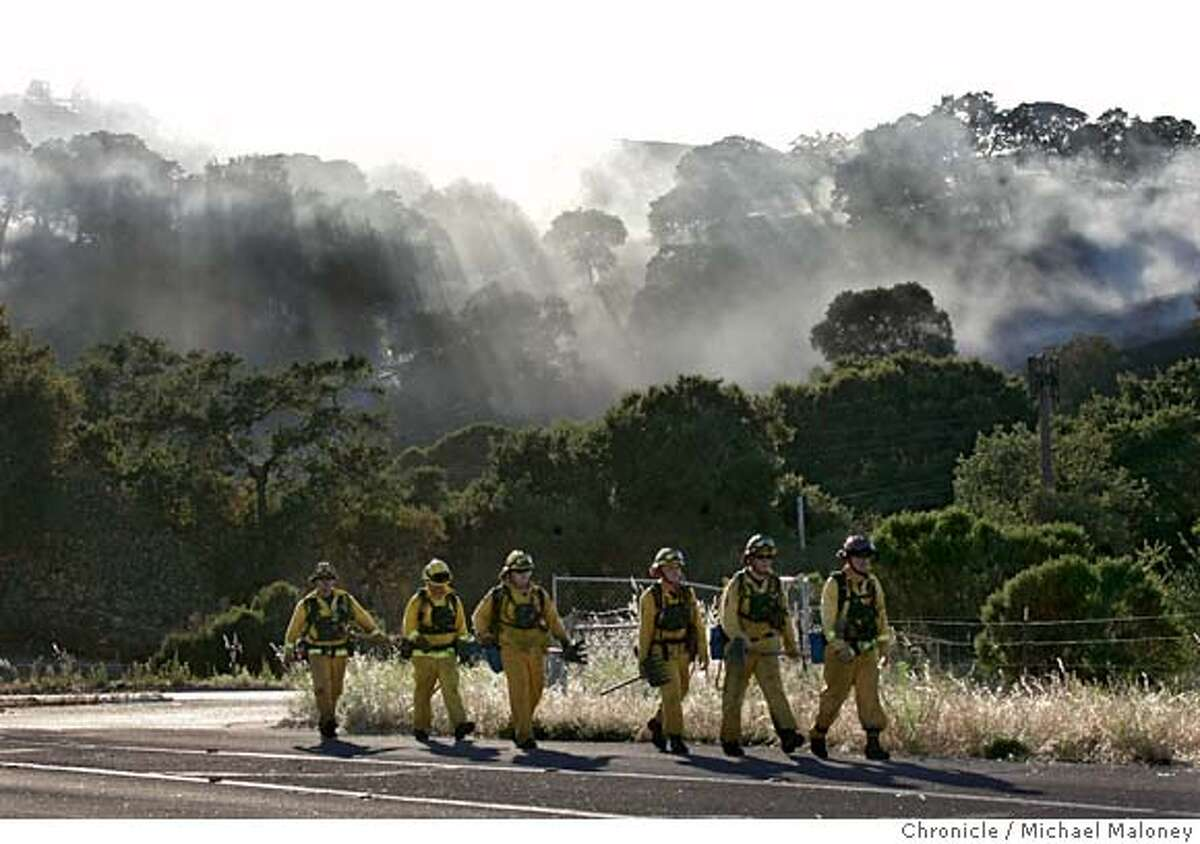 Members of Cal Fire return from fighting the fire in the hills near Stanford. Helicopters dropped water Monday June 25, 2007 on a 130-acre brush fire in the hills west of Palo Alto. The three-alarm blaze was reported about 4:40 p.m. between Stanford University and Interstate 280 and was contained by early evening. Photo by Michael Maloney / San Francisco Chronicle ***