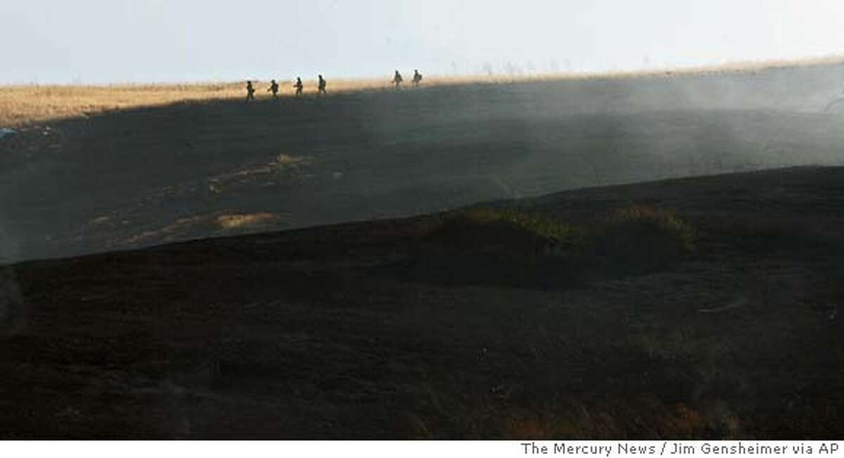 Fire crews prepare to work the fire by hand after air support put out most of a brush fire on Stanford University property in Stanford, Calif. on Monday, June 25, 2007. (AP Photo/The Mercury News, Jim Gensheime) ** NO SALES **