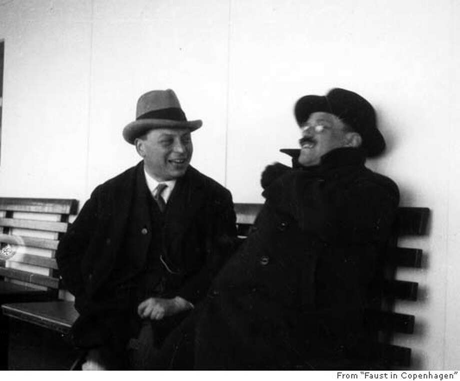 "Wolfgang Pauli and Paul Ehrenfest on the deck of the ferry taking them to Copehagen in April 1930. credit is simply: From ""Faust in Copenhagen"" Photo: Ho"