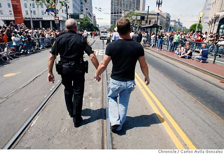 prideparade26006_cag.jpg  Partners Kevin Heuer, left, and Todd Leichleiter, march down Market Street in San Francisco during the 36th Annual Gay Pride Parade on Sunday, June 25, 2006. Photographed in San Francisico  Carlos Avila Gonzalez/The Chronicle Ran on: 06-26-2006  Kevin Heuer (left) and Todd Leichleiter are a contingent of two as the parade makes its way through downtown San Francisco.  Ran on: 06-26-2006 Ran on: 06-26-2006  Kevin Heuer (left) and Todd Leichleiter are a contingent of two as the parade makes its way through downtown San Francisco.  Ran on: 06-24-2007  Kevin Heuer (left) and Todd Leichleiter walk in last year's parade. In 1965, San Francisco police were accused of trying to intimidate revelers at a gay ball. Photo: Carlos Avila Gonzalez