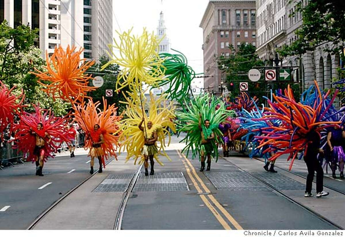 prideparade26009_cag.jpg Members of Balloon Magic make their way down Market Street in San Francisco, Ca., on Sunday, June 25, 2006, for the 36th Annual Gay Pride Parade. Photographed in San Francisico Carlos Avila Gonzalez/The Chronicle Ran on: 06-24-2007 Kevin Heuer (left) and Todd Leichleiter walk in last years parade. In 1965, San Francisco police were accused of trying to intimidate revelers at a gay ball.