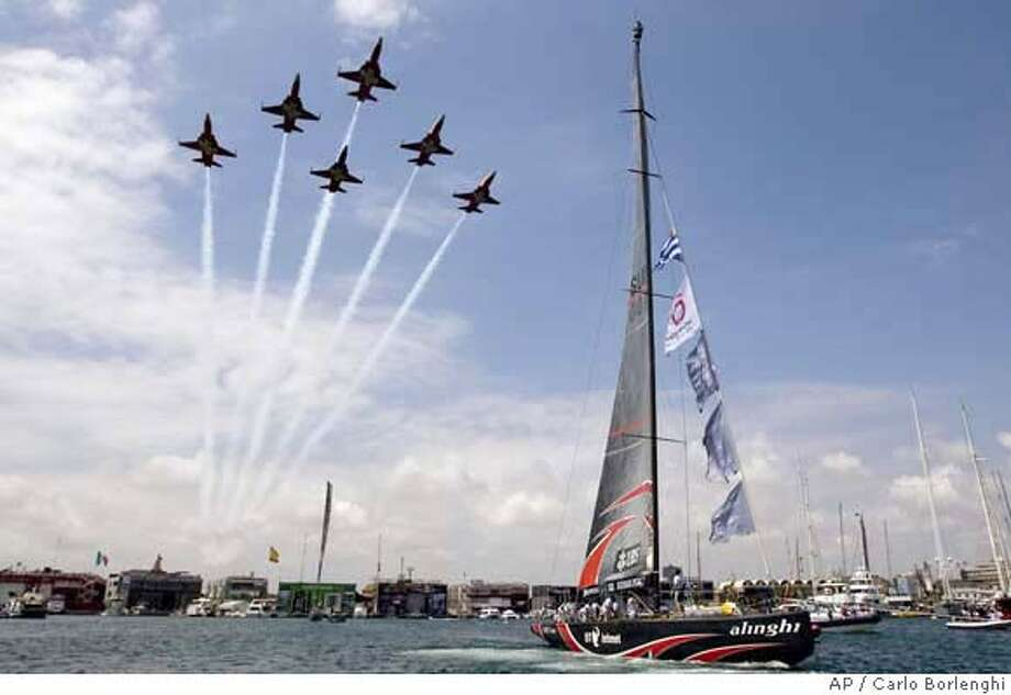 A picture supplied by the America's Cup management shows army planes of the 'Patrouille Suisse' air show fly over Switzerland's Alinghi during a ceremony marking the start of the 32nd America's Cup racing between defender Alinghi from Switzerland and Emirates Team New Zealand in Valencia, Spain, Saturday, June 23, 2007. (AP Photo/ACM 2007/Carlo Borlenghi)***Editorial use only, No Sales, No Archives*** Photo: CARLO BORLENGHI