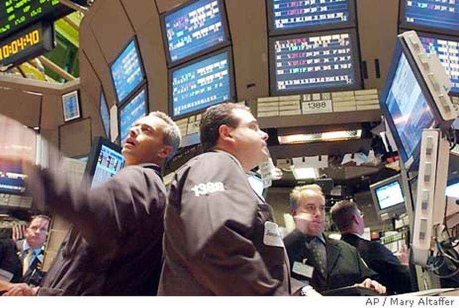 Traders react moments after trading begins on the floor of the New York Stock Exchange, Tuesday, Sept. 30, 2003, in New York. resumed its downward slide Tuesday following disappointing reports on consumer confidence and business activity in the Midwest. The Dow Jones industrials dropped more than 100 points. (AP Photo/Mary Altaffer) Photo: MARY ALTAFFER