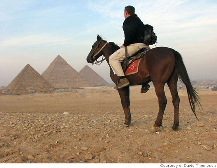 TRAVEL JUSTBACK -- David Thompson, Napa  JUNE 24, 2007  CAPTION: Resting on a rise overlooking the Great Pyramids on my horse Salaam, with Mahmoud, my friendly and knowledgable guide taking the photo.  Contact info: Email: nyingma113@yahoo.com  Daytime phone number: 707-260-5290 C_Documents and SettingsDavid ThompsonDesktopDavid Egypt 2007025 Horseback riding at Giza!!.jpg  2/9/07 in , . Photo: HO