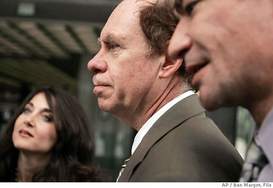 Ed Rosenthal, center, appears with his lawyers, Shari Lynn Greenberger, left, and Robert Amparan, outside a Federal courtroom Tuesday, May 15, 2007, in San Francisco. Ganja guru Ed Rosenthal returned to court Tuesday for opening arguments in a case federal prosecutors are retrying even though the pot advocate will face no prison time if convicted of growing marijuana. (AP Photo/Ben Margot) Photo: Ben Margot