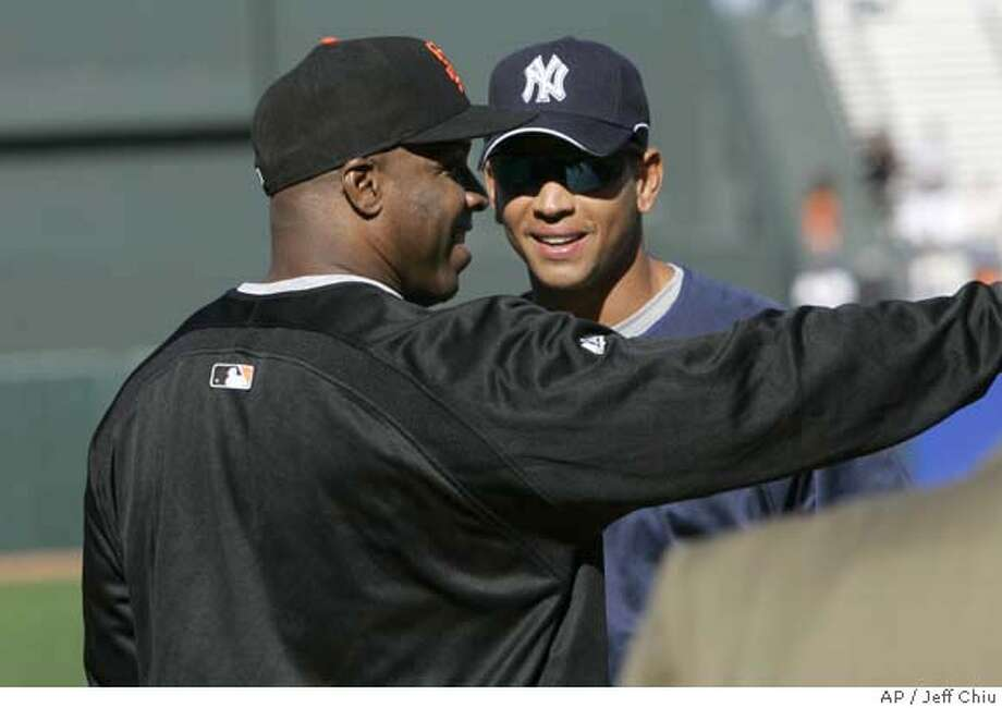 San Francisco Giants' Barry Bonds, left, talks with New York Yankees' Alex Rodriguez during batting practice before their baseball game in San Francisco, Friday, June 22, 2007. (AP Photo/Jeff Chiu) Photo: Jeff Chiu