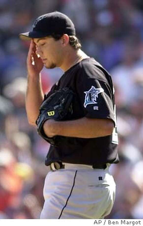 Florida Marlins pitcher Josh Beckett wipes his brow as San Francisco Giants Barry Bonds comes to the plate in the fourth inning during game 1 of the National League Division Series playoff game, Tuesday, Sept. 30, 2003 in San Francisco. The Giants beat the Marlins, 2-0. (AP Photo/Ben Margot) Photo: BEN MARGOT