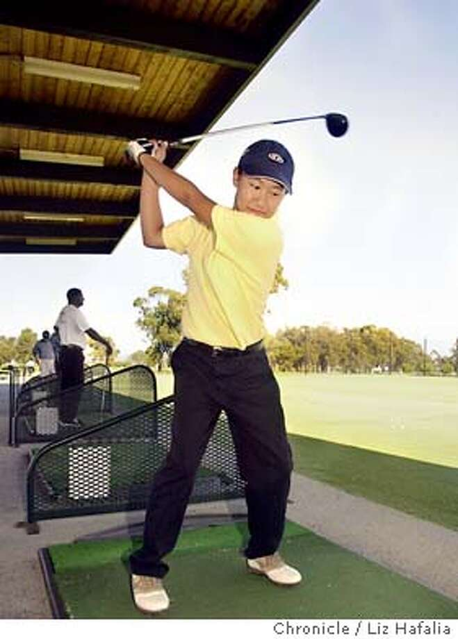 Ki-Shui Liao, 15 years old, is an outstanding young golfer who competes on the boys team of Alameda High school. She practices nearly every day and is at the driving range of Chuck Corica Golf Course. Shot on 7/3/03 in Alameda. LIZ HAFALIA / The Chronicle Photo: LIZ HAFALIA