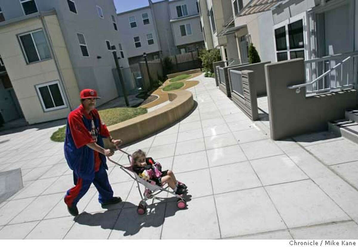 AFFORDABLEHOUSING24_050_MBK.JPG Resident Eltro Nelson and 2-year-old daughter Jamie walk back to their home at Valencia Gardens, a recently redesigned affordable housing projects in San Francisco, CA, on Friday, June, 22, 2007. photo taken: 6/22/07 Mike Kane / The Chronicle *Eltro Nelson Jamie MANDATORY CREDIT FOR PHOTOG AND SF CHRONICLE/NO SALES-MAGS OUT