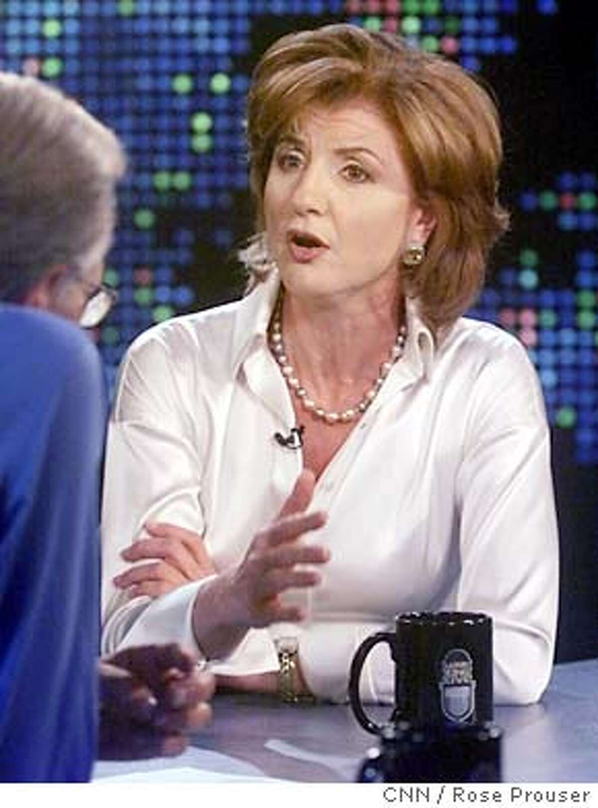 Arianna Huffington, Independent California gubernatorial recall candidate, announces she has decided to withdraw as a candidate so she can devote all her time and energy in the remaining week to defeating the recall, and to defeating Arnold Schwarzenegger, during an interview with talk show host Larry King (L) on the CNN program