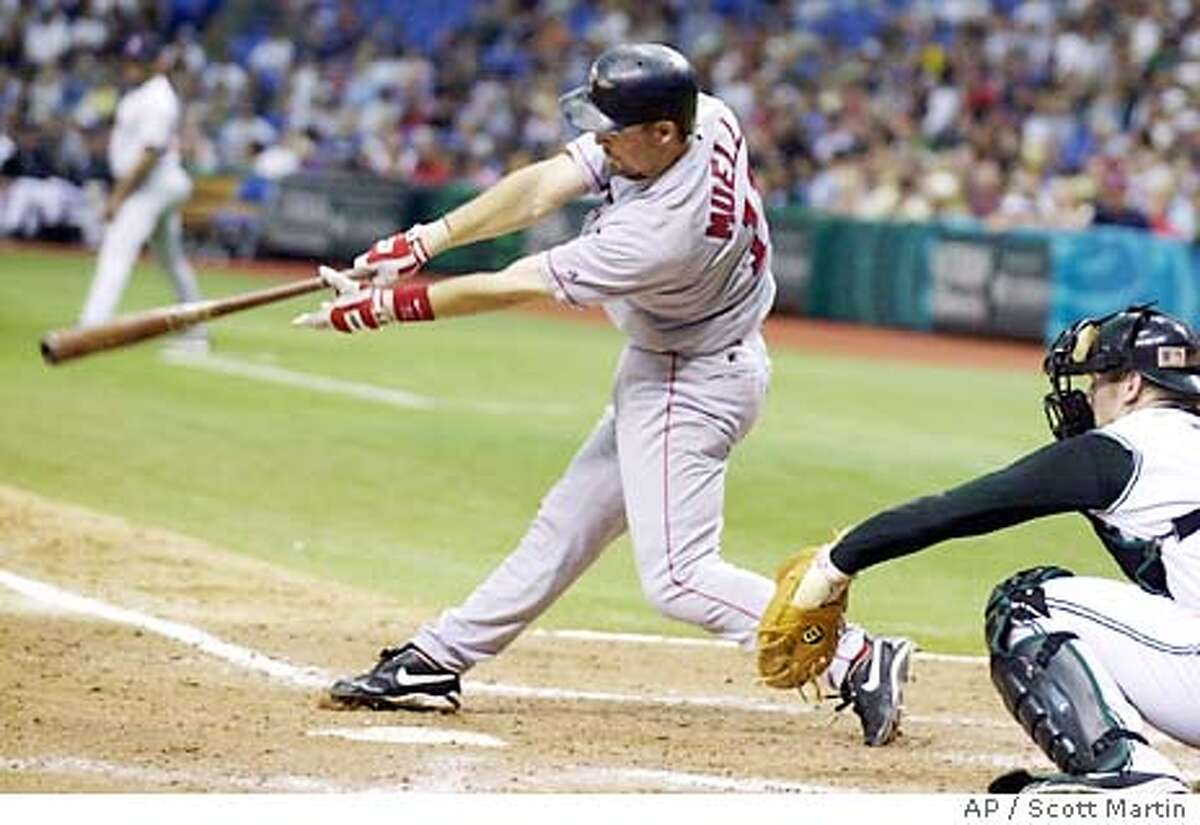 Boston Red Sox's Bill Mueller follows through on a grounder in front of Tampa Bay Devil Rays catcher Toby Hall in the eighth inning Sunday afternoon, Sept. 28, 2003, in St. Petersburg, Fla. Andy Abad was out at second on the fielder's choice. Mueller won his first batting title as the Red Sox lost, 3-1. (AP Photo/Scott Martin)