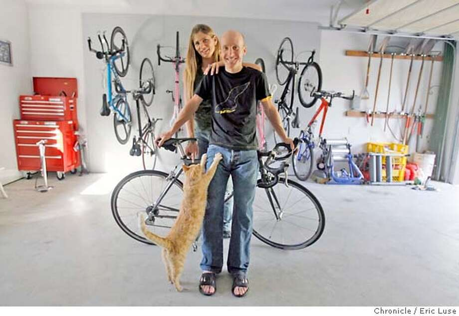.JPG  In the garage where his training bikes are stored with his wife. Levi Leipheimer, will be racing with a new team in Tour de France at home in Santa Rosa he shares with his wife Odessa Gunn  Photographer:  Eric Luse / The Chronicle names cq from the source Levi Leipheimer  Odessa Gunn MANDATORY CREDIT FOR PHOTOG AND SF CHRONICLE/NO SALES-MAGS OUT Photo: Eric Luse