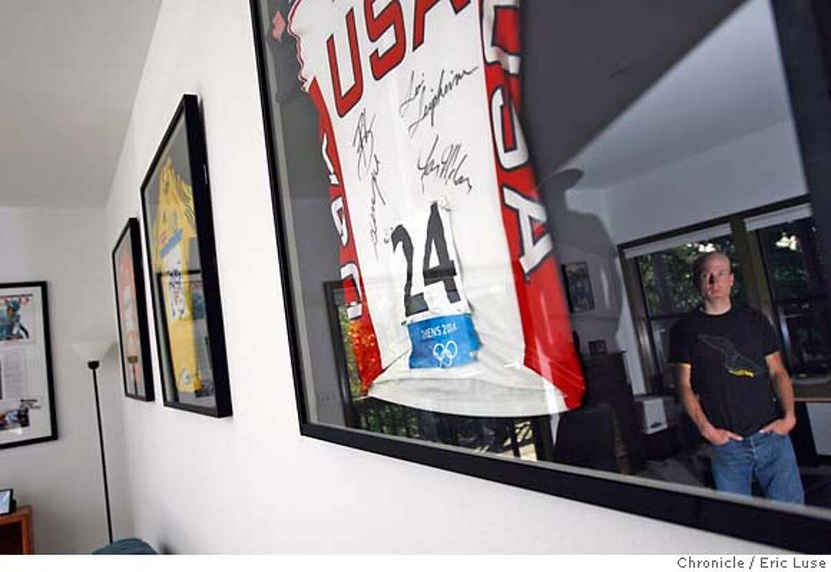 .JPG In the office reflected in the frame of one of his jersey's. This one from the Olympics. Levi Leipheimer, will be racing with a new team in Tour de France at home in Santa Rosa he shares with his wife Odessa Gunn Photographer: Eric Luse / The Chronicle names cq from the source Levi Leipheimer Odessa Gunn MANDATORY CREDIT FOR PHOTOG AND SF CHRONICLE/NO SALES-MAGS OUT