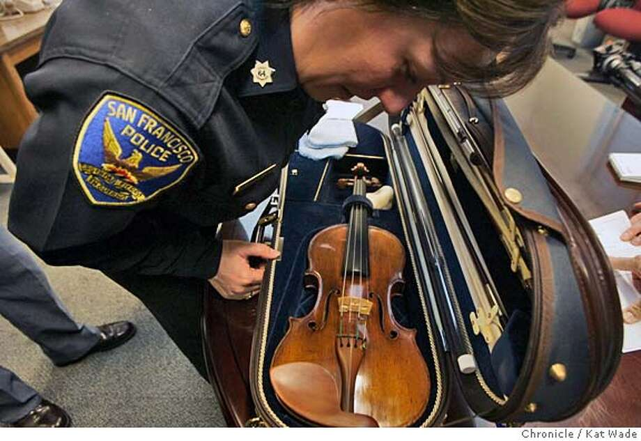 VIOLIN31_0047_KW_.jpg On 12/30/05 in San Francisco police department spokesperson Maria Oropez attempts to read the name of the inside the body of the instrument during a press conference at the Hall of Justice. According to police public affairs officers, today investigators recovered the missing Nicolo Gagliano 18th century worth at least $175,000 dollars when church staff of St. Roberts Church in San Bruno reported that the was found on the steps of their church. San Francisco police have determined that the original report of theft, made by Sabina Rhee-Nakajima, was a false police report and that the was never stolen. Kat Wade/The Chronicle MANDATORY CREDIT FOR PHOTOG AND SF CHRONICLE/ -MAGS OUT Photo: Kat Wade