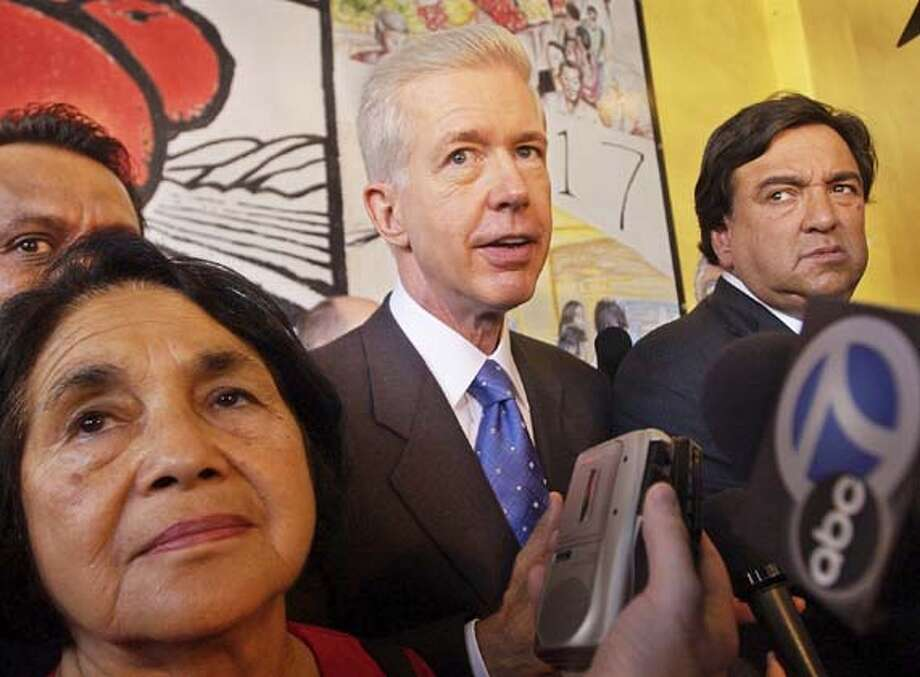 California Gov. Gray Davis, center, is joined by Dolores Huerta, co-founder of the United Farm Workers of America, left, and New Mexico Gov. Bill Richardson as he campaigns in Los Angeles' downtown Grand Central Market, Monday, Sept. 29, 2003. (AP Photo/Nick Ut) Photo: NICK UT