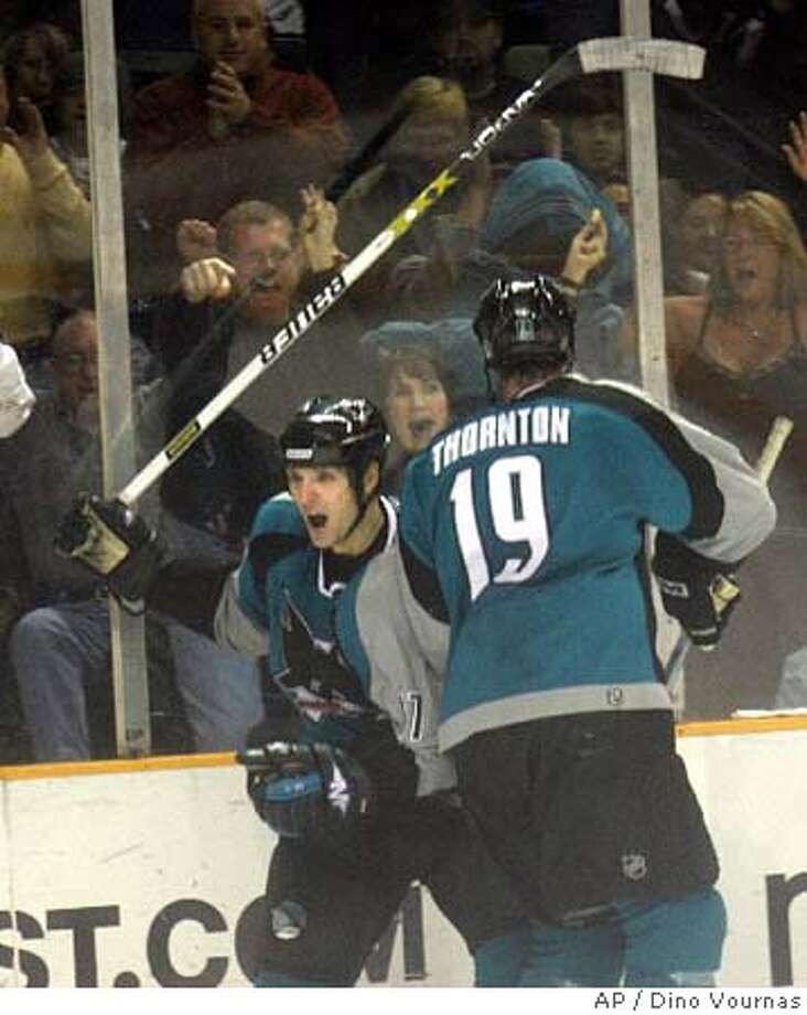THORNTON  San Jose Sharks' Scott Thornton, left, celebrates the Sharks' third goal against the Colorado Avalanche with teammate Joe Thornton, in the second period of an NHL hockey game Friday, Dec. 30, 2005 in San Jose, Calif. (AP Photo/Dino Vournas)  Ran on: 12-31-2005  Scott Thornton (left) and Joe Thornton celebrate a second-period Sharks goal