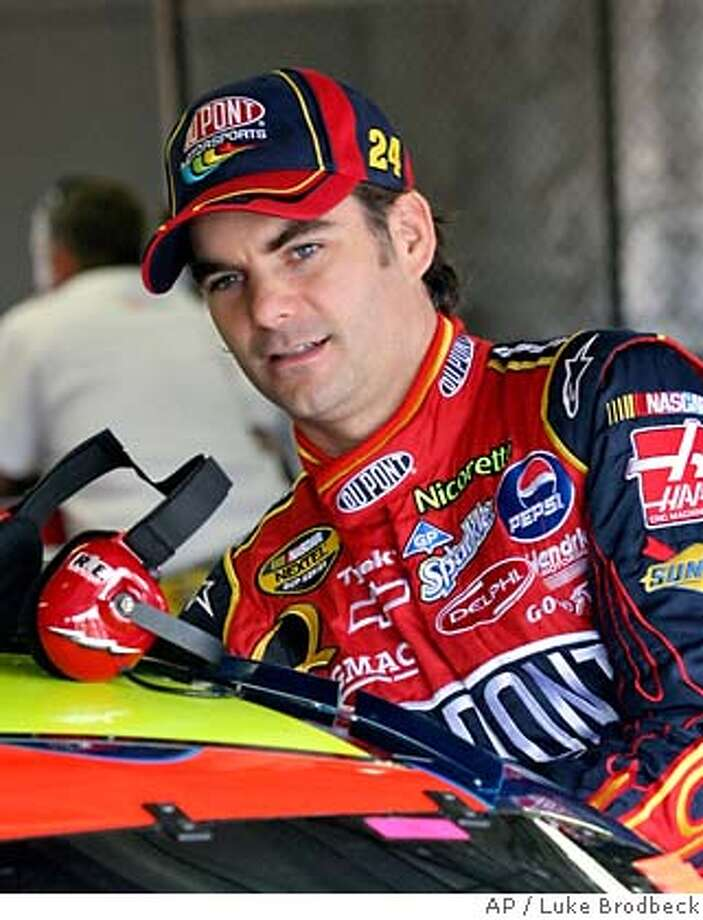 Hendricks Motorsports driver Jeff Gordon enters his car at Michigan International Speedway in Brooklyn, Mich., Saturday, June 16, 2007. With a pair of superstar drivers in Gordon and Jimmie Johnson and an unbelievable winning percentage this season, Hendrick Motorsports was already the best in NASCAR. The addition of Dale Earnhardt Jr. next season will make the team a Murder's Row on wheels, and make beating them even harder. (AP Photo/Luke Brodbeck) Photo: Luke Brodbeck