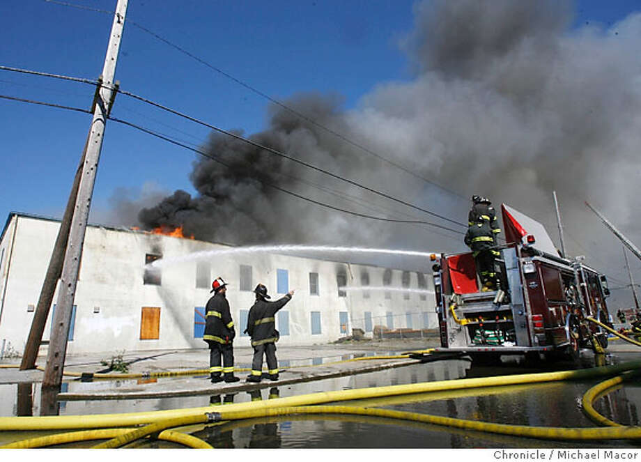 Hugh warehouse fire breaks out at the corner of Avenue N and 4th St. on Treasure Island early this morning. Photographed in, San Francisco, Ca, on 6/21/07. Photo by: Michael Macor/ The Chronicle Photo: Michael Macor