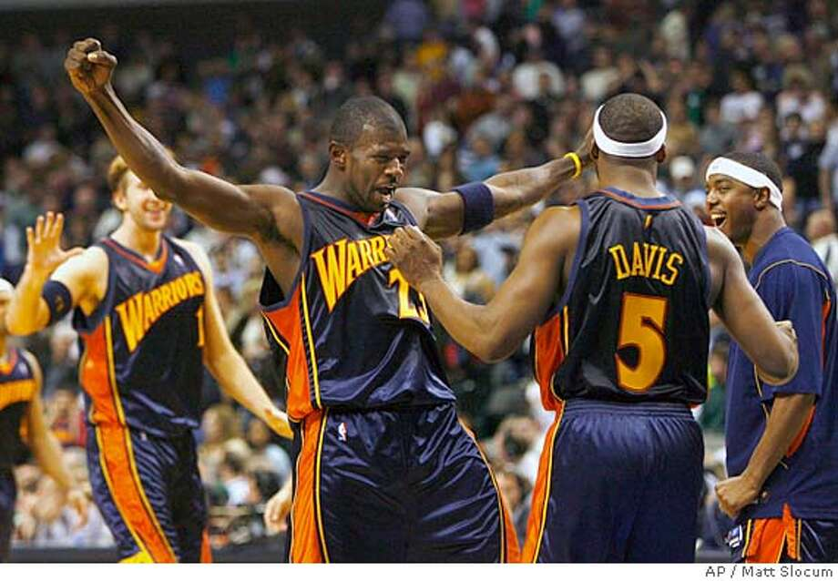 Golden State Warriors forward Troy Murphy (1) and guard Jason Richardson (23) celebrate with Baron Davis (5), after Davis made the game-winning shot against the Dallas Mavericks in the second half of an NBA basketball game Friday, Dec. 30, 2005, in Dallas. The Warriors won 111-109. (AP Photo/Matt Slocum) EFE OUT Photo: MATT SLOCUM