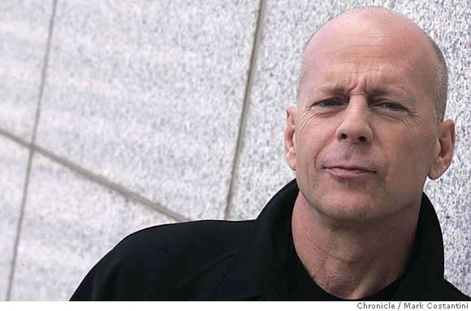 "Bruce Willis -- for story on ""Die Hard"" movie, ""Live Free or Die Hard."" He's pictured here at the Mandarin Hotel . PHOTO: Mark Costantini / The Chronicle MANDATORY CREDIT FOR PHOTOGRAPHER AND SAN FRANCISCO CHRONICLE/NO SALES-MAGS OUT Photo: MARK COSTANTINI"