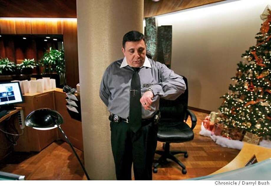 "jerry_0009_db.jpg  Jerry Longoria checks his watch as he works as a security guard at the front desk at 500 Washington Street. Longoria is one of the subjects in ""Waging A Living,"" a new documentary.  Event on 12/22/05 in San Francisco.  Darryl Bush / The Chronicle MANDATORY CREDIT FOR PHOTOG AND SF CHRONICLE/ -MAGS OUT Photo: Darryl Bush"