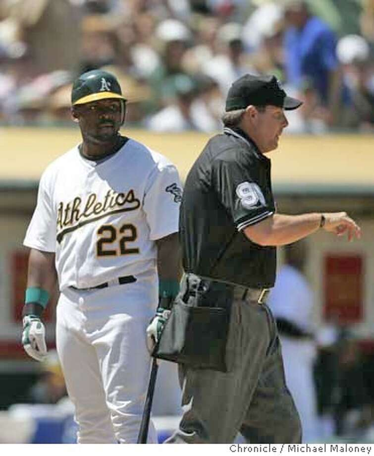 Oakland Athletics Milton Bradley glares at umpire Tim Timmons after Bradley was called out on a questionable strike call in the 7th inning.  The Oakland Athletics host the Cincinnati Reds at McAfee Coliseum in Oakland, CA on Wednesday, June 20, 2007.  Photo by Michael Maloney / San Francisco Chronicle ***roster/code replacement MANDATORY CREDIT FOR PHOTOG AND SF CHRONICLE/NO SALES-MAGS OUT Photo: Michael Maloney