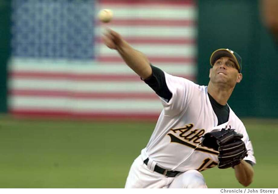 athletics041_jrs.jpg  The A's vs. the Boston Red Sox at the Network Coliseum.  8/11/03 in Oakland. Tim Hudson pitches against the red Sox. JOHN STOREY / The Chronicle Photo: JOHN STOREY