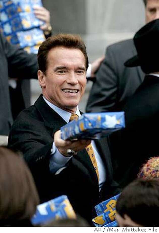 SCHWARZENEGGER  Gov. Arnold Schwarzenegger hands out gifts during the 12th annual Hanukkah celebration at the Capitol in Sacramento, Calif., on Tuesday, Dec. 20, 2005. (AP Photo/Max Whittaker)  Ran on: 12-27-2005  The soccer stadium that formerly featured Arnold Schwarz- enegger's moniker (above) is now named only for Liebenau, the district in Graz, Austria, where it is located (left).