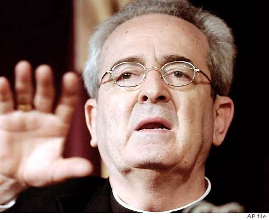 **FILE** Archbishop Justin Francis Rigali gestures as he responds to questions during a news conference in St. Louis, MO., in this July 16 2003 file photo. Rigali was among the list of 30 new Cardinals named by the Pope at the Vatican Sunday, Sept. 28 2003. The new Cardinals will be elevated in a consistory to be held at the Vatican next Oct. 21. (AP Photo/James A. Finley) Photo: JAMES A. FINLEY