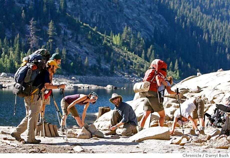 vermillion_0005_db.JPG  Erin Moutinho, 23, of El Sombronte, CA., left center, and Frank Fermat, 29, of San Francisco, both center (kneeling), share a laugh with fellow backpackers as they get ready for their hike at the Edison ferry Landing Trailhead after they crossed Edison Lake by ferry from the Vermilion Valley Resort at Edison Lake in the Sierra National Forest in Fresno County, CA on Thursday, September 7, 2006. 9/7/06  Darryl Bush / The Chronicle ** Erin Moutinho, Frank Fermat (cq) MANDATORY CREDIT FOR PHOTOG AND SF CHRONICLE/NO SALES-MAGS OUT Photo: Darryl Bush