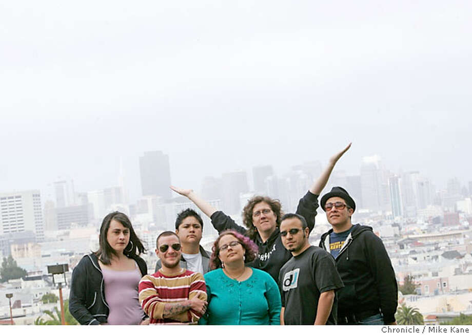 OUTLOUD21_095_MBK.jpg  Sarafina Maraschino, left to right, Rocco Kayiatos, Nico Dacumos, Gina de Vries, Susan Stryker, Prado Gomez, and Storm Florez, all of TransForming Community, at Dolores Park in San Francisco, CA, on Saturday, June, 16, 2007. photo taken: 6/16/07  Mike Kane / The Chronicle *Sarafina Maraschino, Rocco Kayiatos, Nico Dacumos, Gina de Vries, Susan Stryker, Prado Gomez, and Storm Florez Photo: MIKE KANE