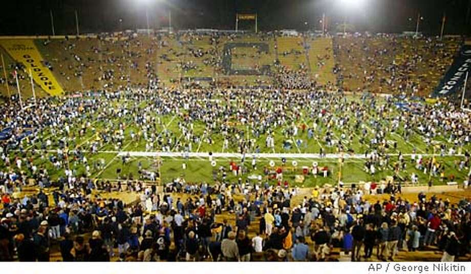 California fans swarm the field after California upset Southern California, 34-31, Saturday Sept. 27, 2003, at Memorial Stadium in Berkeley, Calif. (AP Photo/George Nikitin) Photo: GEORGE NIKITIN