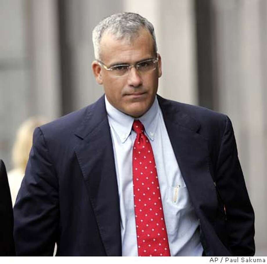 **FILE**Brocade's former CEO Gregory Reyes, walks into a federal courthouse in San Francisco, in this Wednesday, Aug. 2, 2006 file photo. Reyes either masterminded a stock options backdating scheme designed to defraud investors, or fell victim to murky accounting laws and heightened public scrutiny to corporate accounting errors, lawyers said Monday, June 18, 2007. The criminal trial against Reyes, charged with 10 felony counts of securities fraud and other offenses, began Monday in a federal courtroom. Reyes' case is the first to go to trial alleging criminal offenses connected to suspect timing of stock option awards. (AP Photo/Paul Sakuma, file) AUGUST 2, 2006 FILE PHOTO Photo: Paul Sakuma