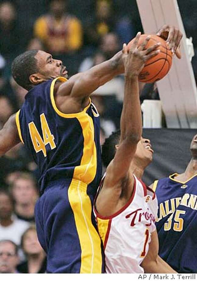 California's Leon Powe, left, blocks the shot of Southern California's Nick Young during the first half of a college basketball game Thursday night, Dec. 29, 2005, in Los Angeles. (AP Photo/Mark J. Terrill) Photo: MARK J. TERRILL