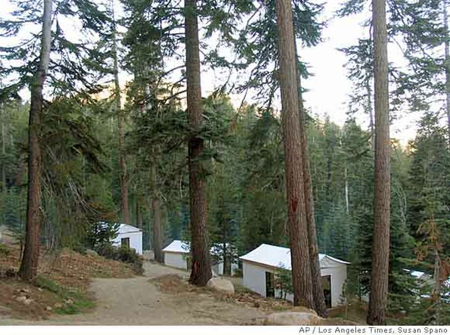 ** ADVANCE WEEKEND OCT 28-29 FILE ** Thirty six tents in clusters, each outfitted with plump beds, double sheeted and with Pendleton blankets for camping comfort, are seen Aug. 19, 2006, at Sequoia High Sierra Camp in Giant Sequoia National Monument. (AP Photo/Los Angeles Times, Susan Spano) ** MANDATORY CREDIT, MAGS OUT, NO SALES, NO FOREIGN ** Photo: SUSAN SPANO